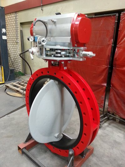 Our custom-made interlock system on a butterfly valve from Bray Controls